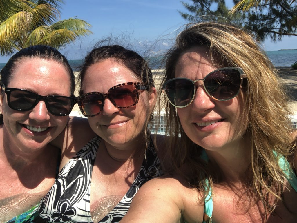 Gadabout Gals poolside soaking in Belize and building dreams
